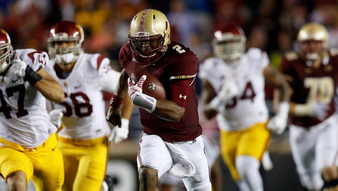 Boston College quarterback Tyler Murphy (2) sealed a 37-31 victory on this touchdown run Saturday.