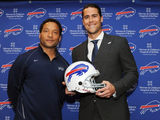 Bills general manager Doug Whaley, left, and quarterback Matt Cassel pose for a photo during Cassel's news conference in Orchard Park.