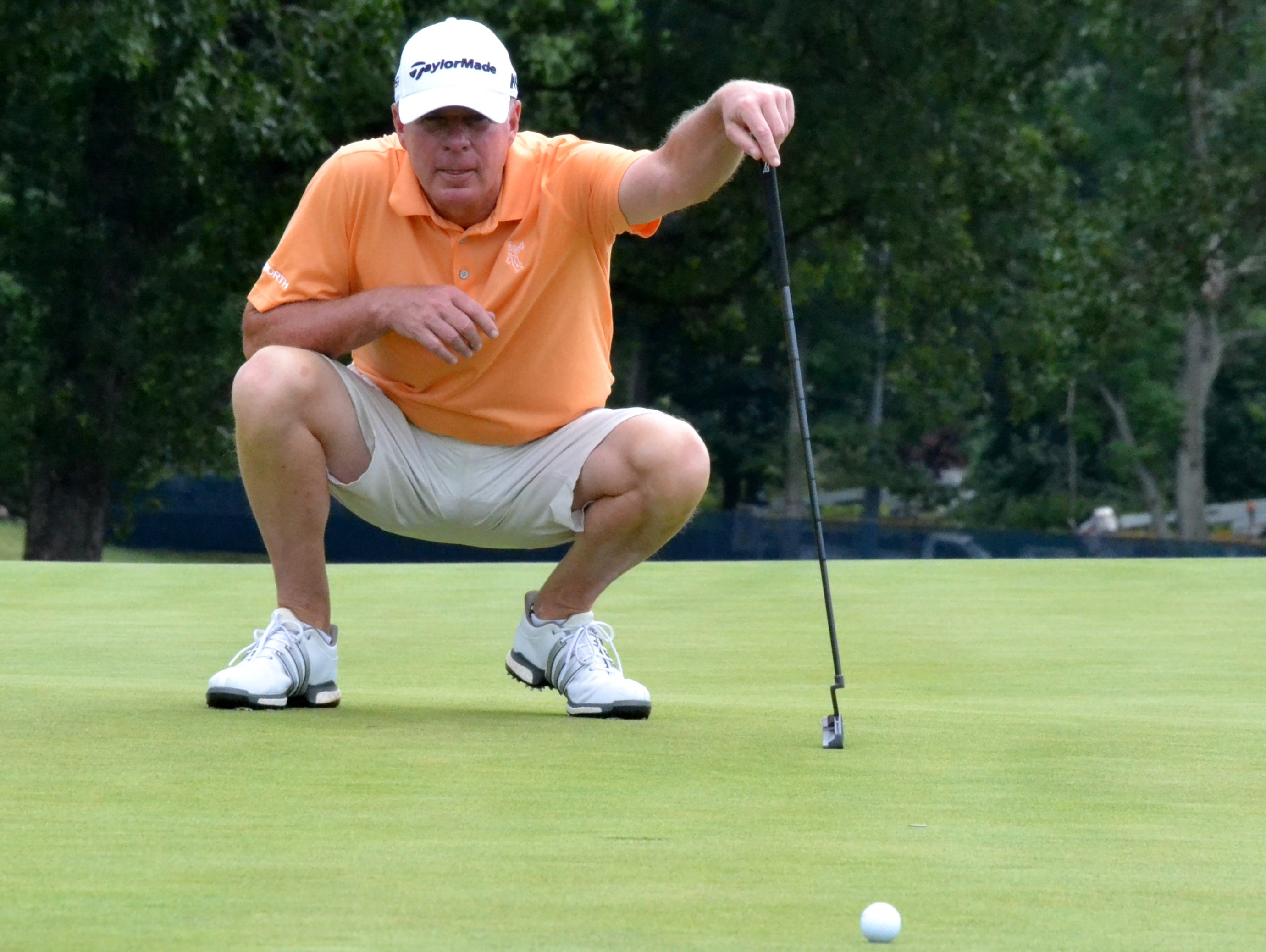 Deepdale member and Rye native George Zahringer III lines up a putt on the 17th green at Essex County Country Club on Monday during the opening round of the Ike Championship. He shot a 1-over 72 and withdrew, citing a health issue.