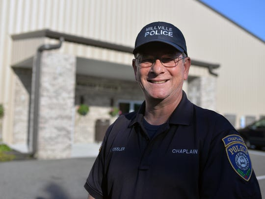 Millville police chaplain Bob Ossler poses for a photograph