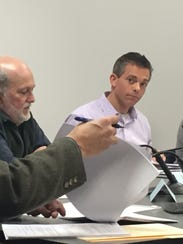 Director of Planning and Zoning Dean Pierce looks through zoning bylaws with Planning Commission member Dick Elkins and Chairman Jaime Heins on Thursday, Dec. 15, 2016.