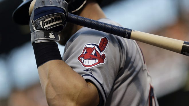The old Chief Wahoo logo is shown on an Indians jersey in 2015. The Indians removed the logo from their uniforms and caps in 2019.
