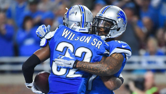 Oct 23, 2016; Detroit, MI, USA; Lions safety Tavon Wilson celebrates with Glover Quin after recovering a fumble during the second quarter against the Washington Redskins at Ford Field.