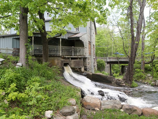 Water cascades into the adjacent Walkill River at Tuthill