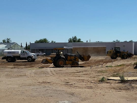Workers moved dirt on Monday as part of Phase 2 of