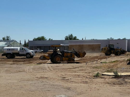 Workers moved dirt on Monday as part of Phase 2 of a large-scale construction project at Las Cruces High School. An official said the phase of the project got underway in earnest on Monday, the same day students returned to classes for the fall semester.