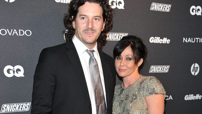 """FILE - In this Oct. 27, 2010 file photo, actress Shannen Doherty, right, and Kurt Iswarienko attend 'The Gentleman's Ball' hosted by GQ Magazine at the Edison Ballroom in New York. Doherty and husband Iswarienko sued her former accountants and business managers on Wednesday, Aug. 19, 2015, accusing them of mismanaging her money and causing the cancellation of her health insurance in 2014. The """"Beverly Hills 90210"""" star's lawsuit states Doherty was recently diagnosed with breast cancer and her doctors have told her it worsened during the period when her health insurance had lapsed. (AP Photo/Evan Agostini, File)"""