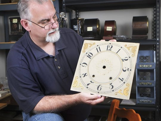 Clock and watch repairman Michael Sater shows an antique clock dial on Wednesday, July 13, 2016, in Maryville. Sadler recently relocated from Bloomington, Indiana, and runs his Tennessee Clock Works business from a home workshop. (PAUL EFIRD/NEWS SENTINEL)
