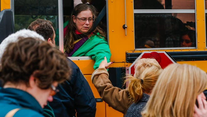 Multiple students were injured and the principal was killed Tuesday, Jan. 26, 2016, when a school bus jumped a curb at Amy Beverland Elementary School in Lawrence.