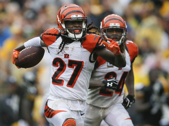 Cincinnati Bengals cornerback Dre Kirkpatrick (27), left, celebrates one of his three interceptions this year.