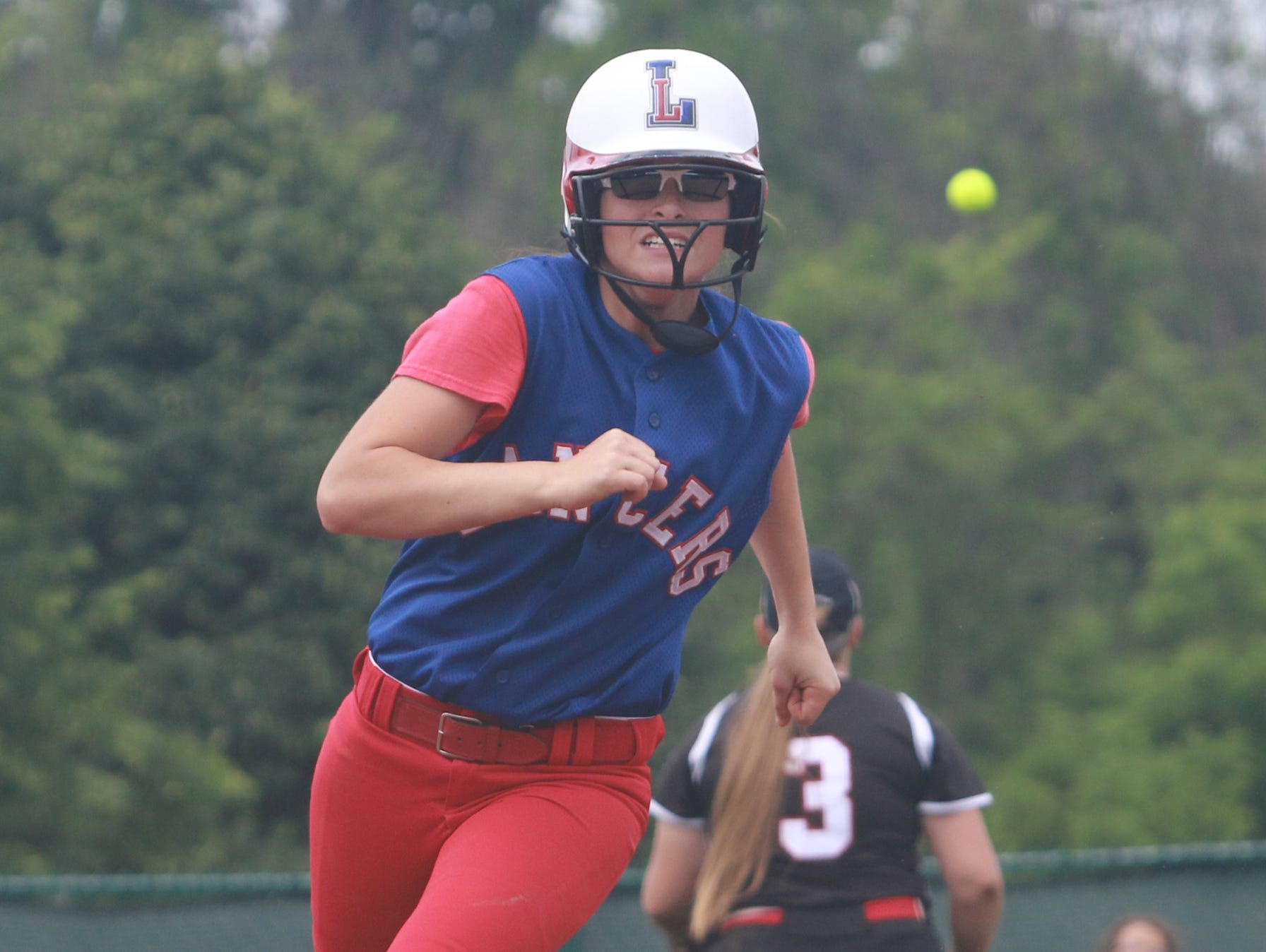 Lakewood's Kristin Peacock rounds second base on her way to a triple during Saturday's Division II regional final against Fairfield Union. The Lancers won 5-0.