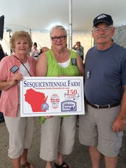 The fourth generation of the Beyer family posed at the State Fair this year, where they received recognition for 150 years. Pictured from left are Suzanne (Beyer) Lemke, owner Linda (Beyer) Struye and Jeff Beyer.