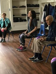 Jackie Zimmerman, Older Adults Level 1 class instructor Lisy Espindola, and Robert Perdue, from left, exercise Nov. 9 at the Montclair YMCA on Park Street.