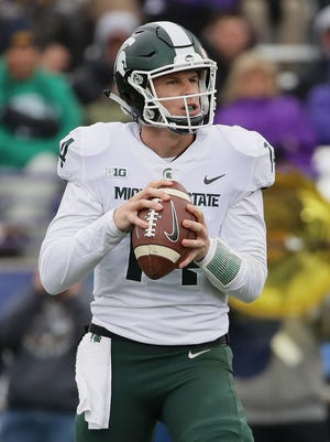 MSU's Brian Lewerke looks for a receiver against  Northwestern at Ryan Field on Saturday, Oct. 28, 2017 in Evanston, Ill.
