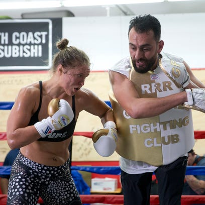 Mixed martial arts fighter Ronda Rousey, left, trains with trainer Edmond Tarverdyan at Glendale Fighting Club, Wednesday, July 15, 2015, in Glendale, Calif. Rousey, the UFC bantamweight champion, will return to the octagon against Brazilís unbeaten Bethe Correia at UFC 190 in Rio de Janeiro on Aug. 1. (AP Photo/Jae C. Hong) ORG XMIT: NYOTK