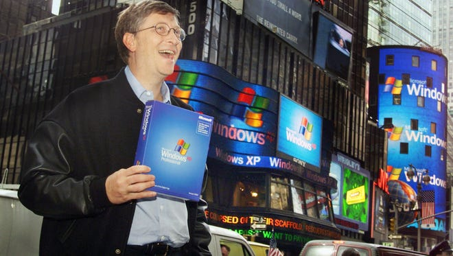 Bill Gates stands in Times Square to promote the Windows XP operating system on  Oct. 25, 2001, in New York.