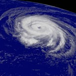 A hurricane spins in the Atlantic in 2006. Federal forecasters predict 3 to 6 hurricanes will form in the Atlantic in 2014.