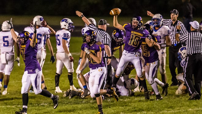 GAME BALL - Oconomowoc's Jason Brandl (10) emerges in possession of the ball after an onside kick by Wisconsin Lutheran in the final seconds of the game at Oconomowoc on Friday, Sept. 28, 2013. Brandl's recovery secured a 84-82 victory for Cooney and advanced the team to 6-0 on the year.