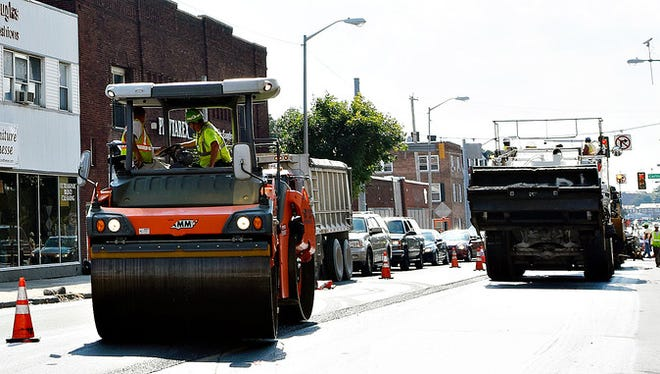 Crews work to pave West Market Street near Belvidere Avenue in downtown York, Pa. on Tuesday, Sept. 8, 2015.