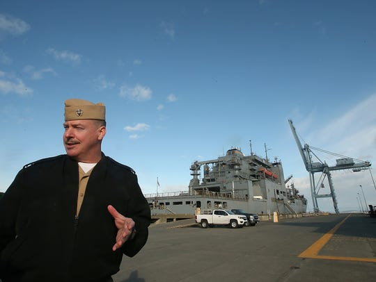 Today, Naval Magazine Indian Island, with Commanding Officer Cmdr. Rocky Pulley,  bustles once again. It's capable loading munitions onto any of the vessels in the Navy's fleet. Behind him is USNS Cesar Chavez.
