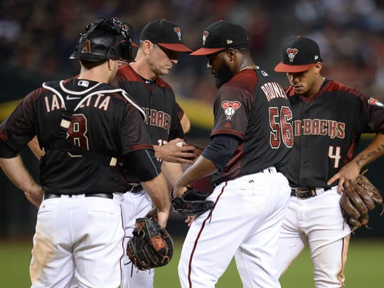 How will Torey Lovullo (second from left) handle his