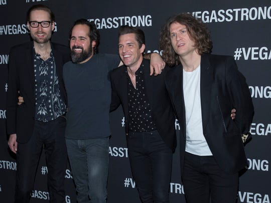 Mark Stoermer, left, Ronnie Vannucci, Brandon Flowers and Dave Keuning of The Killers arrive at the Vegas Strong Benefit concert at T-Mobile Arena, Friday Dec 1, 2017,  in Las Vegas.