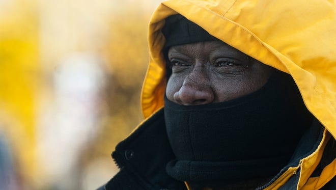 Camden resident Troy Bush shields his face from the cold wind as the city braces for its first arctic cold, Friday Nov. 10, 2017, in Camden.
