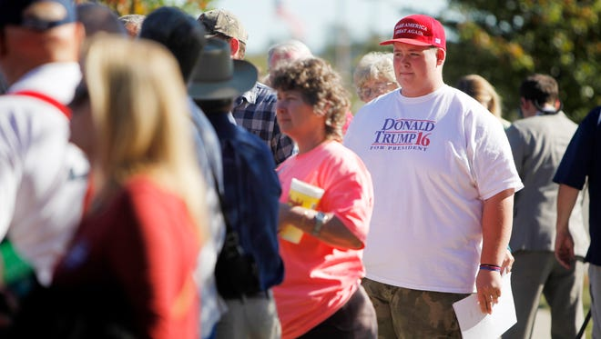 """Derrick Middleton, of Fletcher, waits in line to see Mike Pence speak at the WNC Agriculture Center October 10, 2016. Middleton wanted to hear the vice presidential candidate to """"see if he's going to stick to what he says."""""""