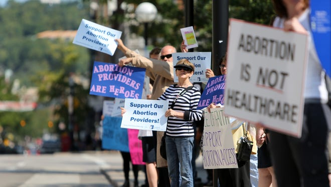 Supporters on both sides of the abortion issue demonstrated in front of the Hamilton County Courthouse in August during a battle over whether to close the Women's Med clinic in Sharonville in 2014.
