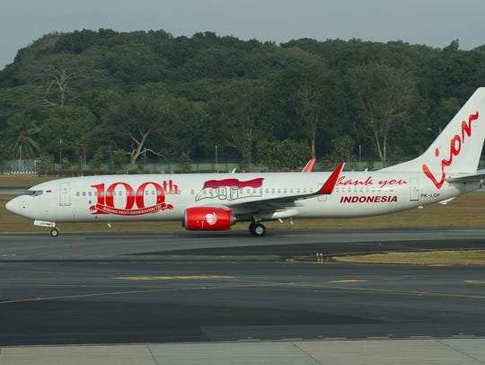 The one hundredth Boeing 737NG for Indonesia-based fully Lion Air taxis to the runway at Singapore Changi World Airport in February 2014.