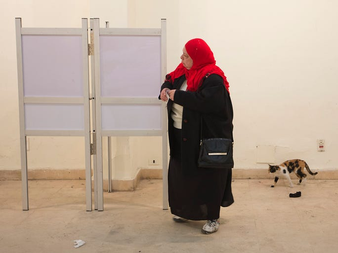 A woman fills her ballot at a polling station during a two-day constitutional referendum on Jan. 15 in Cairo. Egyptians lined up to vote on a new constitution which was drawn up after the military ousted Islamist President Mohamed Morsi six months ago.