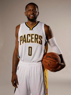 Indiana Pacers guard C.J. Miles (0) poses for a portrait during the NBA basketball team's media day in Indianapolis, Monday, Sept. 29, 2014. (AP Photo/AJ Mast)