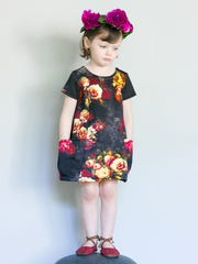 Find this floral dress by Glitter and Wit (available for sizes 12 months to 4T) at the Queen City Craft Show  downtown.