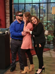 "Rachael Ray hugs Acadiana resident Brittney Reed after her visually impaired boyfriend Hunter Tribe proposed during filming for ""The Rachael Ray Show""  after seeing Reed for the first time through eSight glasses."