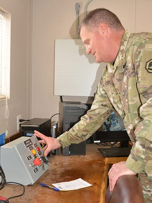 Maj. Gen. Glenn H. Curtis, adjutant general for the Louisiana National Guard, pressed the start button on the first test burn of the contained burn chamber to dispose of M6 propellant, April 13, 2016, at Camp Minden, Minden, La. The burn chamber will be used to dispose 15 million pounds of M6 propellant.