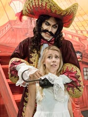 """Captain Hook, portrayed by MTSU senior Daniel Meeks, menaces Wendy Darling, played by MTSU senior Hayley Orozco in this rehearsal photo from the Nov. 3-6 MTSU Arts production of the musical """"Peter Pan."""" Tickets are available at mtsuarts.com, and school matinees also will be held."""