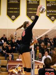 Pleasant junior Laina Sansotta spikes the ball at Northmor.