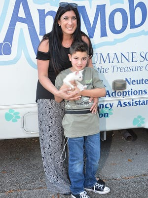 Lisa Zitner and her son, Brodie, 7, with his newly adopted cat, whom he named Link.