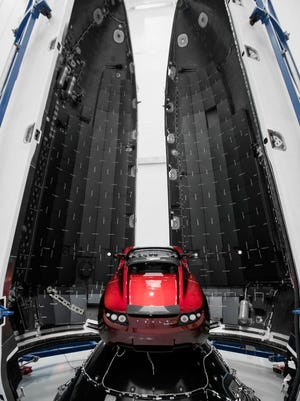 The Tesla Roadster launched Feb. 6, 2018, atop SpaceX's Falcon Heavy rocket on its debut flight, is pictured before its encapsulation inside the rocket's 43-foot-tall payload fairing, or nose cone.