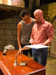 """Brandon Baggin, left, AUM communication and theater major, and Neil David Seibel, a professional actor, review the script for the AUM Theatre production of Shakespeare's """"Measure for Measure."""""""