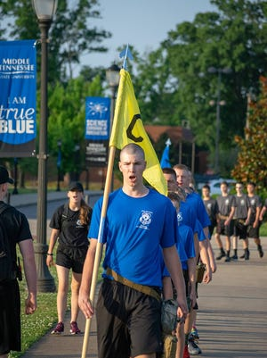 Civil Air Patrol cadets attending the 2018 Tennessee Wing Encampment march along the Science Corridor of Innovation at Middle Tennessee State University.