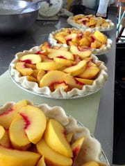 Evansville caterer Ronnie Lee of Ron's Catering is well known for his baking skills. In summer, he makes many fresh peach pies to meet the demands of his clients, with his own homemade crust and a crumb topping.