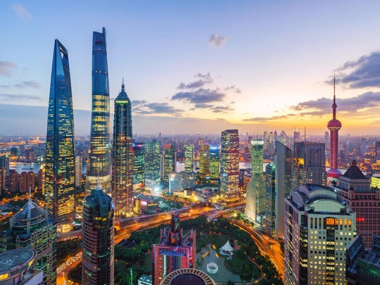 The Shanghai skyline at sunset. Rising wealth means the Chinese public may increasingly view their country as a resurgent power and expect it to start acting like one.