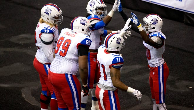 Florida Tarpons' wide receiver Joshua Young, far right, celebrates with teammates after catching a touchdown grab during the first quarter of action at Germain Arena Thursday, June 2, 2016 in Estero.