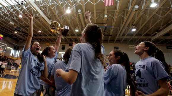 Irvington celebrates their championship win against Briarcliff in the Section 1 Class B girls basketball finals at Pace University March 4, 2018 in Pleasantville.