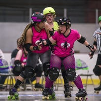 "Elmira-based Dolls of Destruction skaters ""Mount Crushula,"" right, and ""Manic Mayhem,"" left, try to prevent The Parlor City Tricks jammer ""Cherry Bomb"" from passing during a May 2015 match at Chenango Ice Rink."