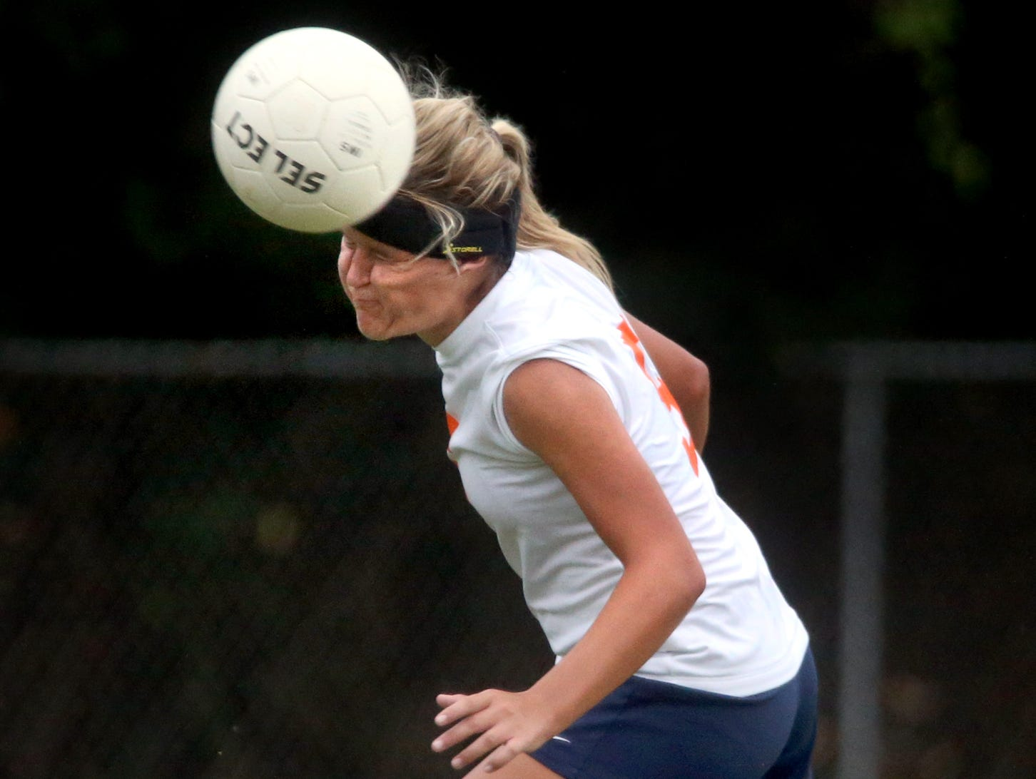 Blackman's Kenzi Vetter heads the ball during a game against Smyrna. The Blackman soccer team wears Storelli head bands to help reduce the risk of concussions.