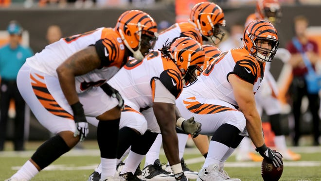 Cincinnati Bengals center Billy Price (53), the team's first-round pick, gets set to snap the ball in the second quarter during the Week 1 NFL preseason game between the Chicago Bears and the Cincinnati Bengals, Thursday, Aug. 9, 2018, at Paul Brown Stadium in Cincinnati.