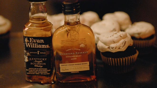 Evan Williams bourbon ball cupcakes are made by Bake Rattle & Roll for the Kentucky Derby Festival event Bourbonville. Evan Williams bourbon ball cupcakes made by Bake Rattle & Roll at the Kentucky Derby Festival event, Bourbonville, held at The Louisville Palace.  April 13, 2017