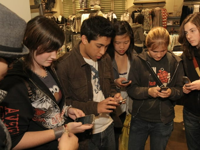 Teen shoppers at the Westfield San Francisco Centre respond to an in-store promotion by texting in on their cellphones.